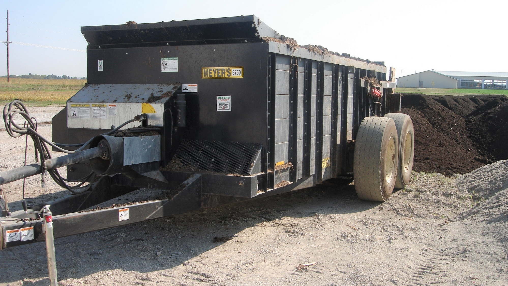 Waggon for placing separation solids in windrows at an Iowa cattle farm.